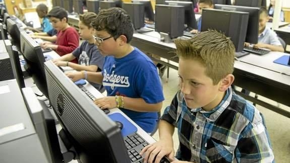 School students working at computer stations